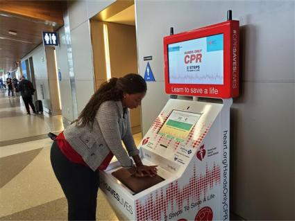 Torrance CitiCABLE reporter Jesse Pierre practiced CPR using the hands-only CPR kiosk.
